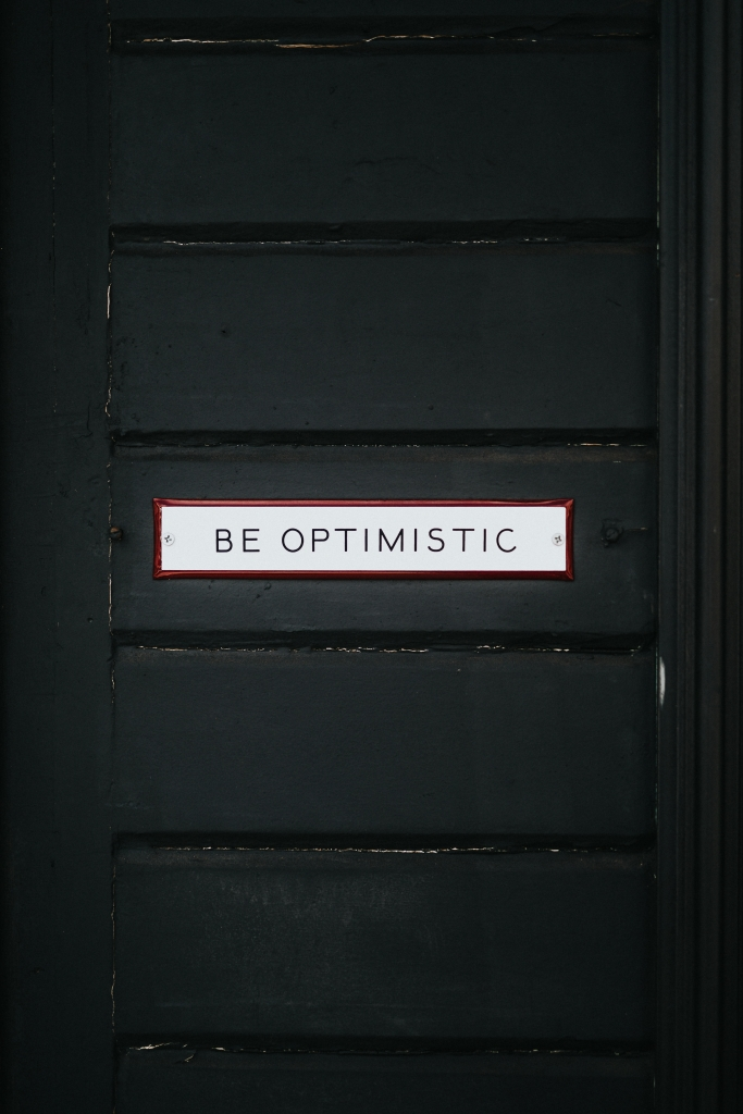 """Door with """"be optimistic"""" on it; Jill Griffin Coaching"""